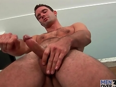 Pouring morning coffee together with masturbating his cock