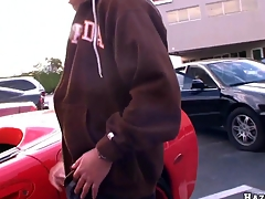 Guy decided to masturbate his giant cock on the parking in front red vette
