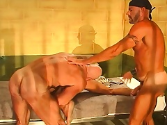 Pretty young stud has two hunky prisoners sharing his ass behind bars